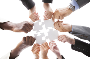 Businesspeople Holding Jigsaw Puzzle